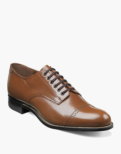 """Known fondly by long-time Stacy Adams fans as the """"Original Stacy Adams Biscuit Toe,"""" this stylish dress shoe is made of soft kidskin leather. Comfortable and practical, the wide range of colors make this shoe a wonderful option no matter where you're headed. Cap toe lace-ups Kidskin leather uppers with leather linings Leather sole Crafted with genuine Goodyear welt construction"""